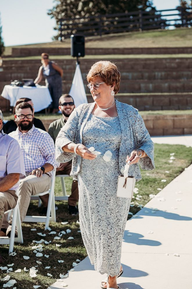 PHOTO: Joyce Raby walks down the aisle at her grandsons wedding in Tennessee.