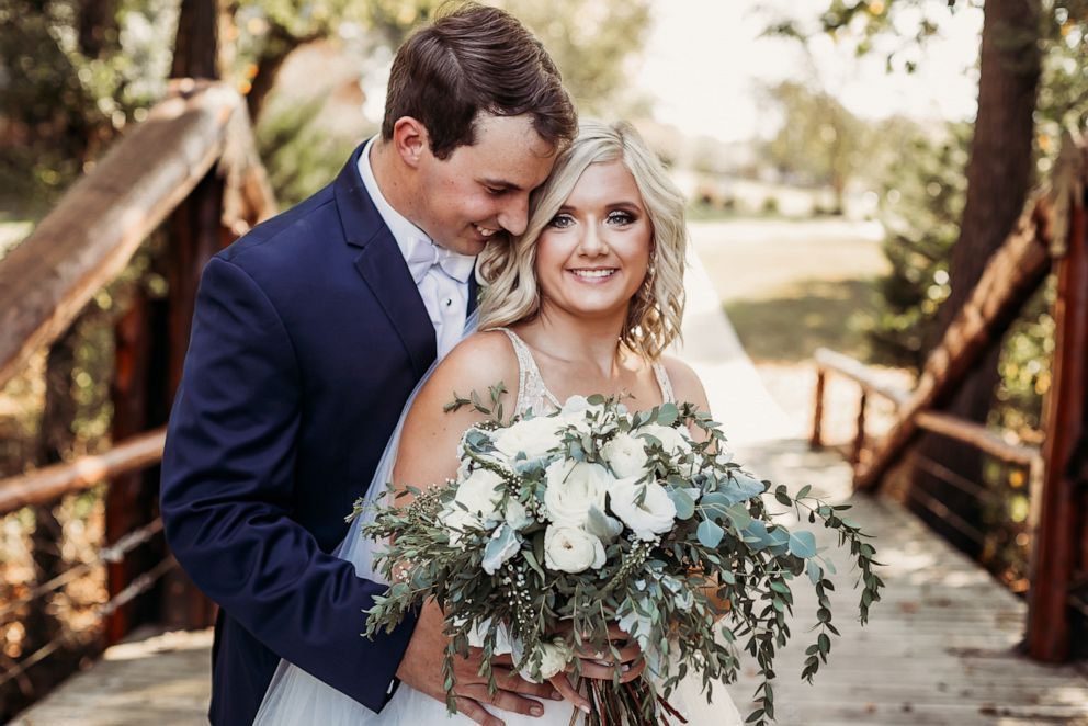 PHOTO: Lyndsey and Tanner Raby pose on their September 22, 2019, wedding day in in Benton, Tennessee.