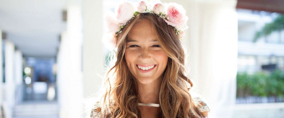 PHOTO: A bride is shown wearing a floral crown.