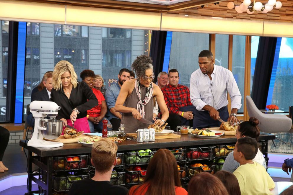 PHOTO: Carla Hall makes wine-can chicken on GMA Day.