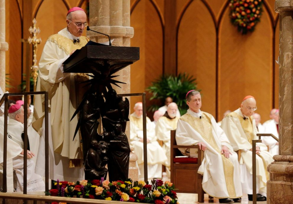 In this Nov. 18, 2014 file photo, Archbishop Carlo Maria Vigano reads the Apostolic Mandate during the Installation Mass of Archbishop Blase Cupich at Holy Name Cathedral, in Chicago.