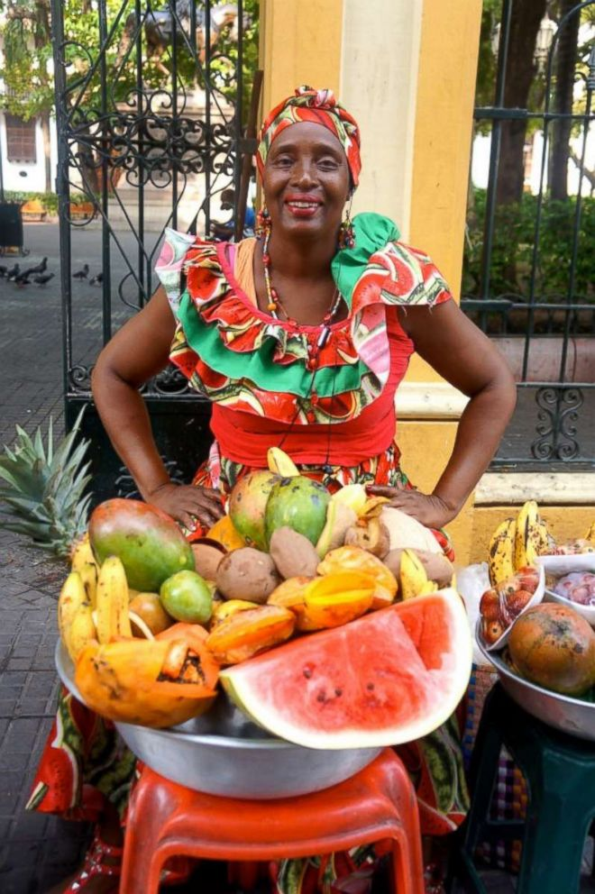 PHOTO: A local fruit vendor poses on the streets of Cartagenas Old City.