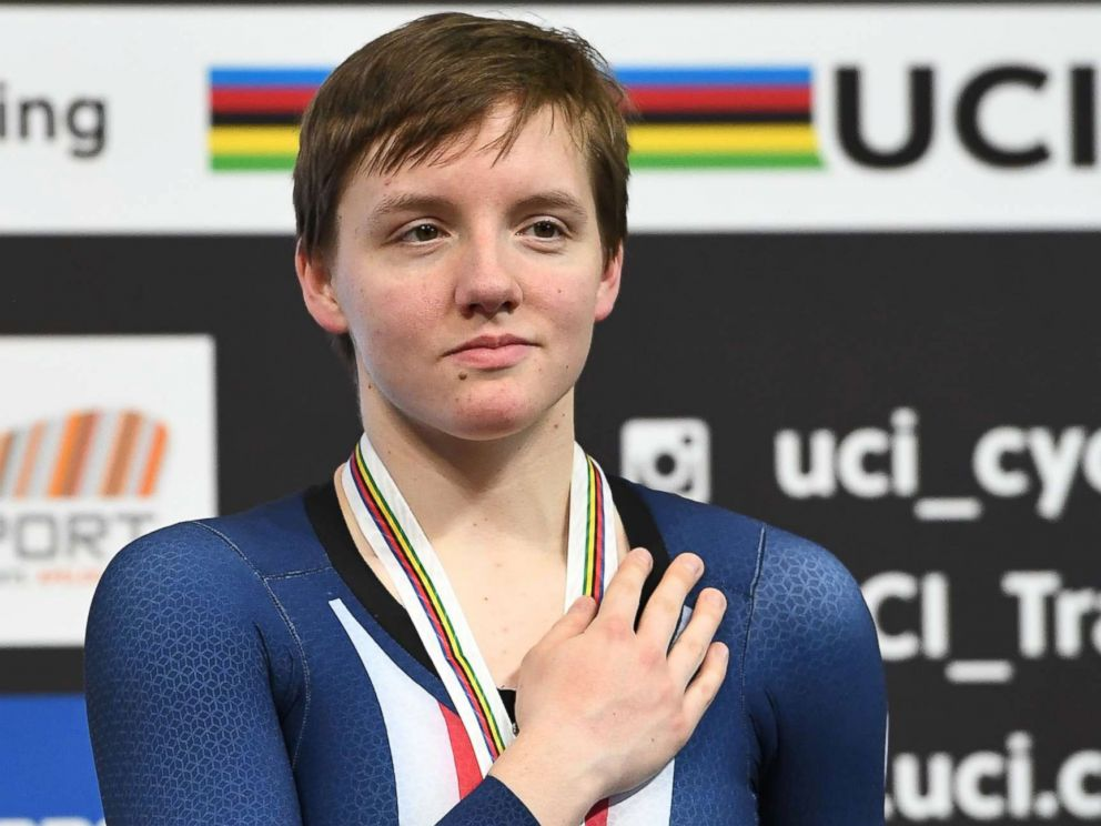 PHOTO: Bronze medalist Kelly Catlin poses on the podium after taking part in the womens individual pursuit final during the UCI Track Cycling World Championships in Apeldoorn, Netherlands, March 3, 2018.