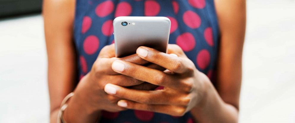 PHOTO: A woman uses a cellphone in this stock photo.