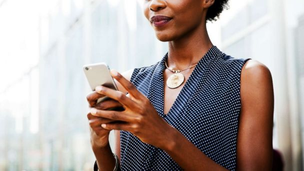 A Woman Uses Cellphone In This Stock Photo