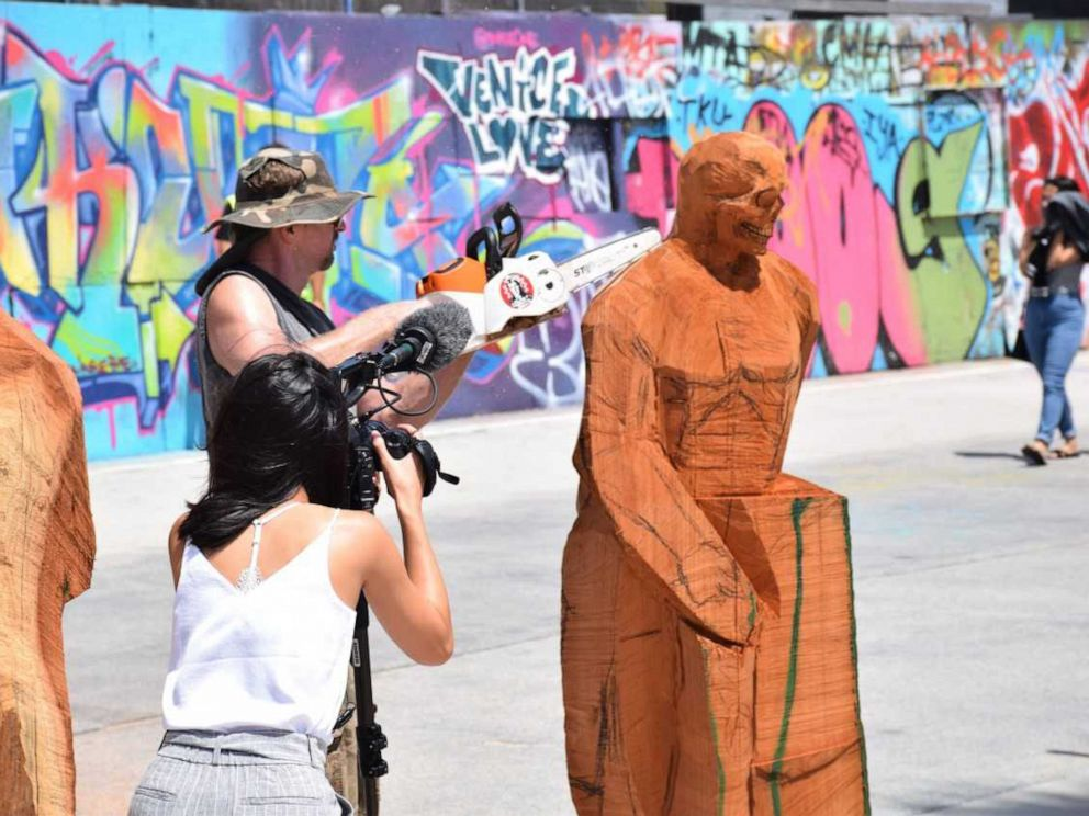 PHOTO: Stacy Poitras live carving at Venice Beach, Calif., July, 2019.