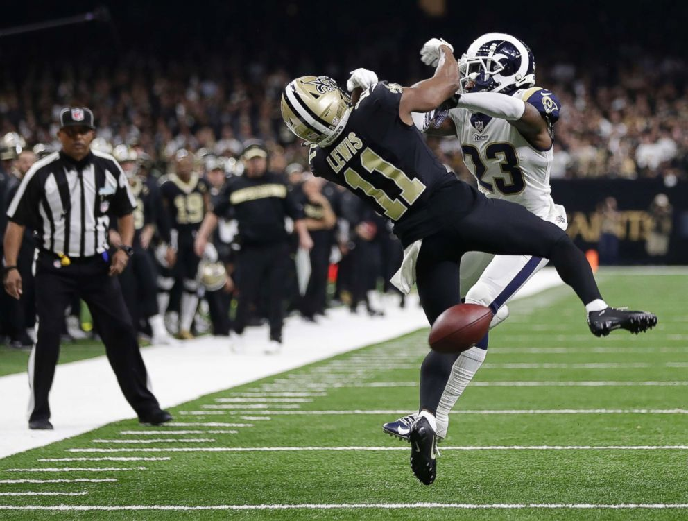 PHOTO: New Orleans Saints wide receiver Tommylee Lewis works for a catch against Los Angeles Rams defensive back Nickell Robey-Coleman during the second half the NFL football NFC championship game, in New Orleans, Jan. 20, 2019.