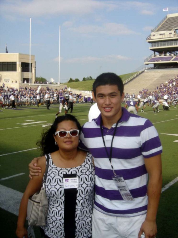 PHOTO: Charles Melton with his mother on recruiting day at Kansas State University.