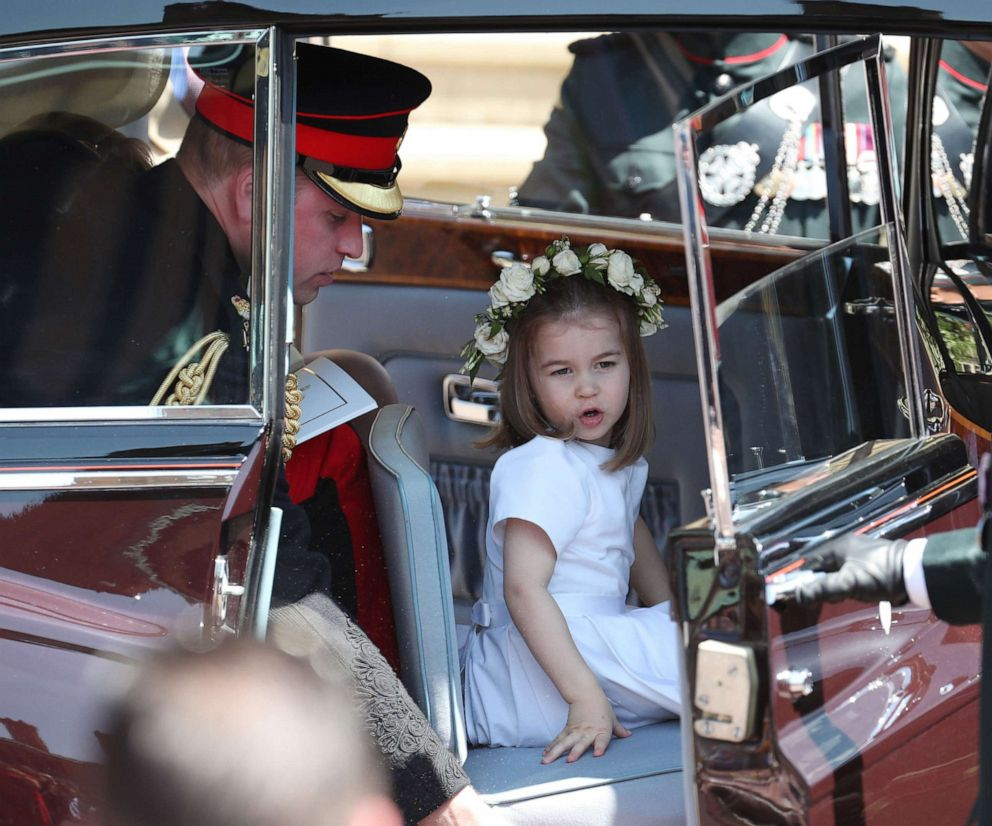 PHOTO: Prince William, Duke of Cambridge and his daughter Princess Charlotte leave after attending the wedding ceremony of Prince Harry, Duke of Sussex and Meghan Markle at St Georges Chapel in Windsor Castle, in Windsor, England, May 19, 2018.