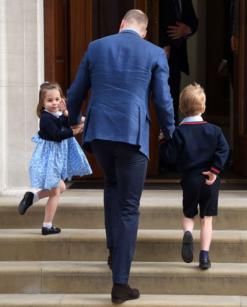 PHOTO: Princess Charlotte waves to the press as she arrives with her father, Prince William, Duke of Cambridge and Prince George to the Lindo Wing of St. Marys Hospital to meet her new baby brother, Louis, April 23, 2018 in London.