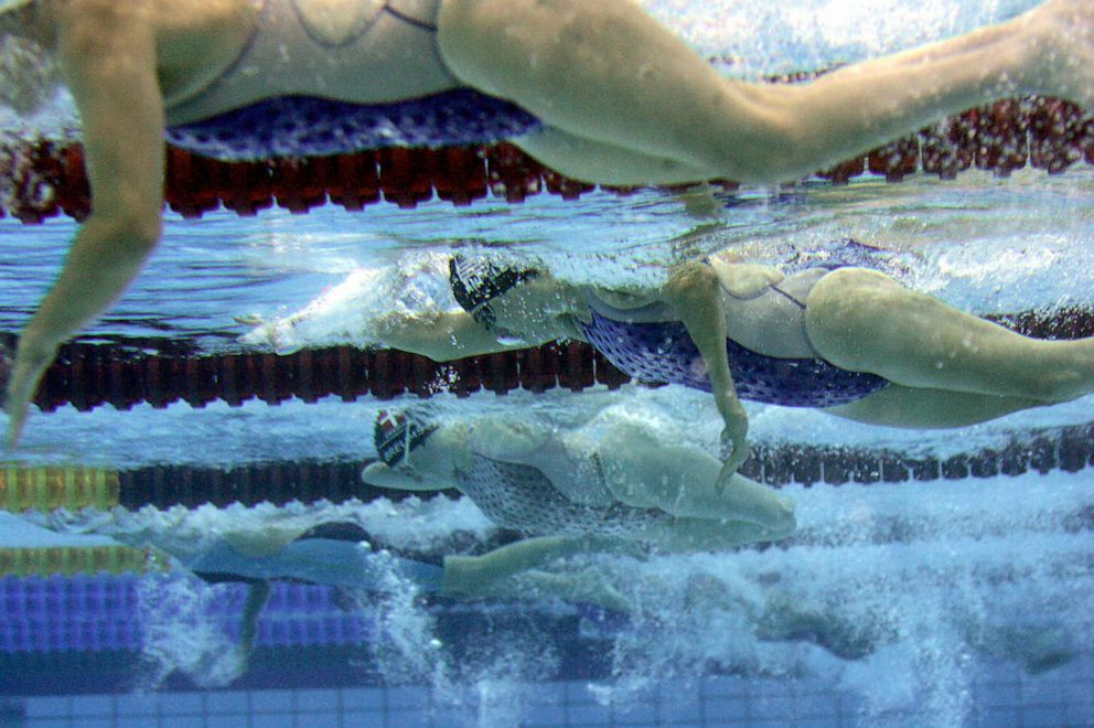 Cheryl Angelelli, second from top, vies in the women's 100 meters freestyle - S4 during the 12th Paralympic Games at the Olympic Aquatic Centre in Athens, Sept. 14, 2004.