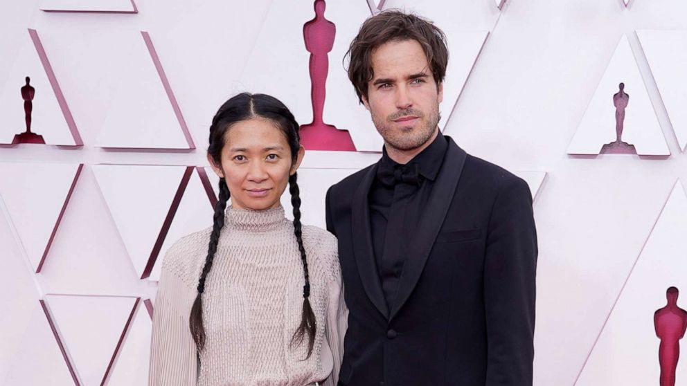 PHOTO: Chloe Zhao and Joshua James Richards arrive to the 93rd Academy Awards, at Union Station, in Los Angeles, April 25, 2021.