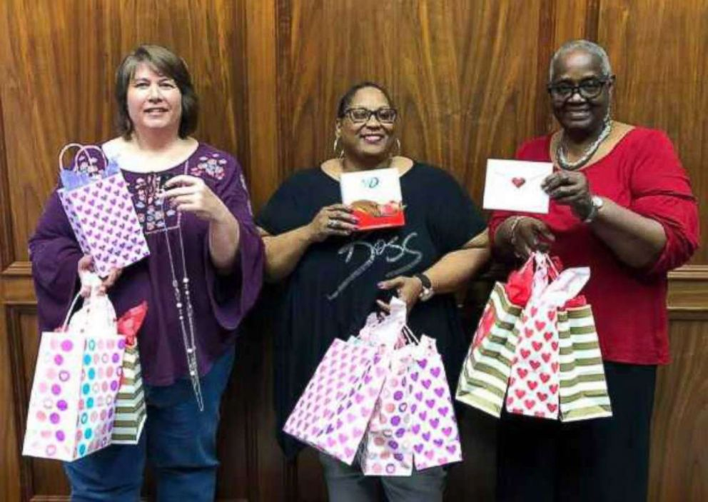 PHOTO: Dedra Moon partnered with volunteers at the Family Services of SETX Womens and Childrens Shelter to help distribute Valentines chocolates to survivors of domestic violence.
