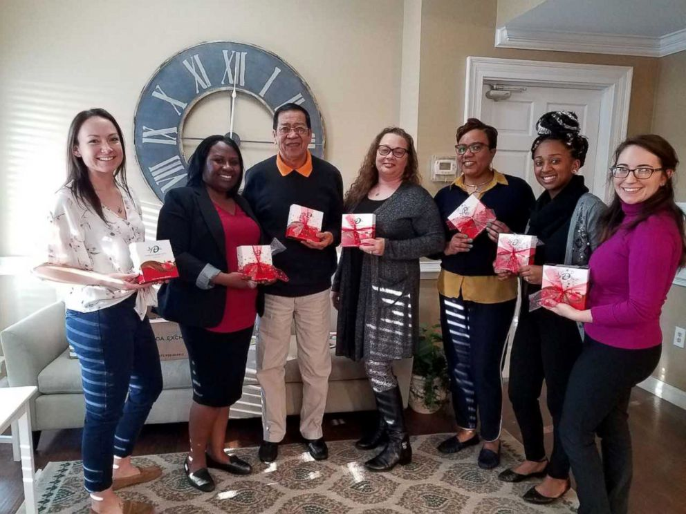 PHOTO: Dedra Moon partnered with volunteers at the Samaritan House shelter to help distribute Valentines chocolates to survivors of domestic violence.