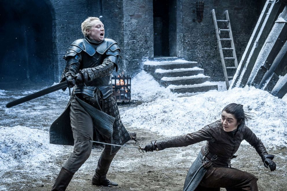 "Gwendoline Christie, left, as Brienne of Tarth, spars against Maisie Williams, as Arya Stark, in a scene from ""Game of Thrones."""