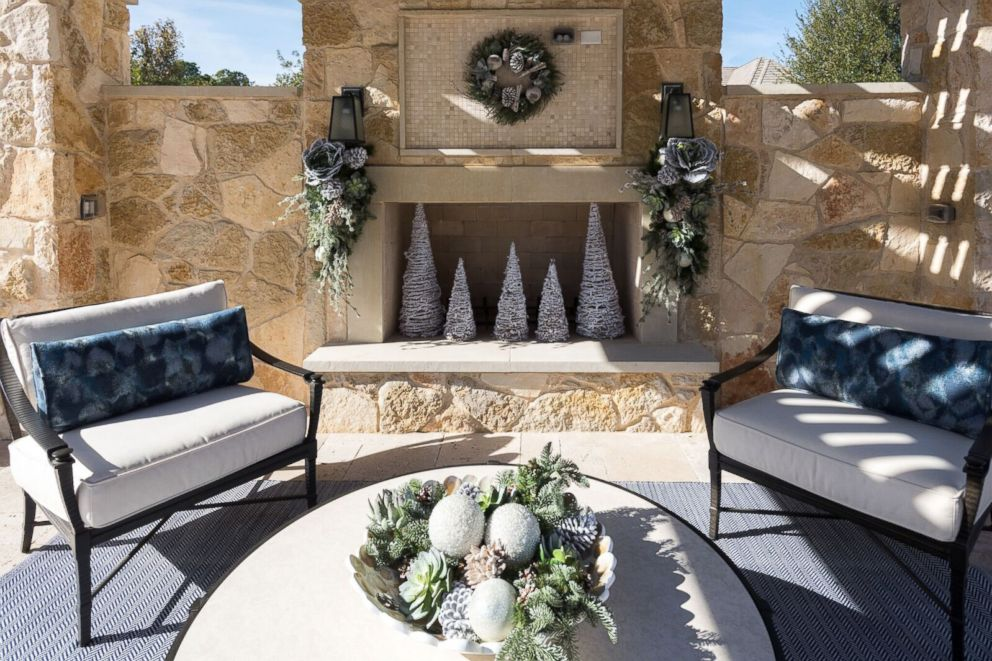 photo an outdoor patio is decorated for christmas by baker design group