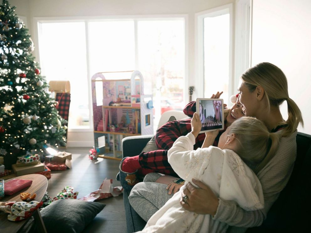 PHOTO: This stock photo depicts a mom with her children on Christmas morning.