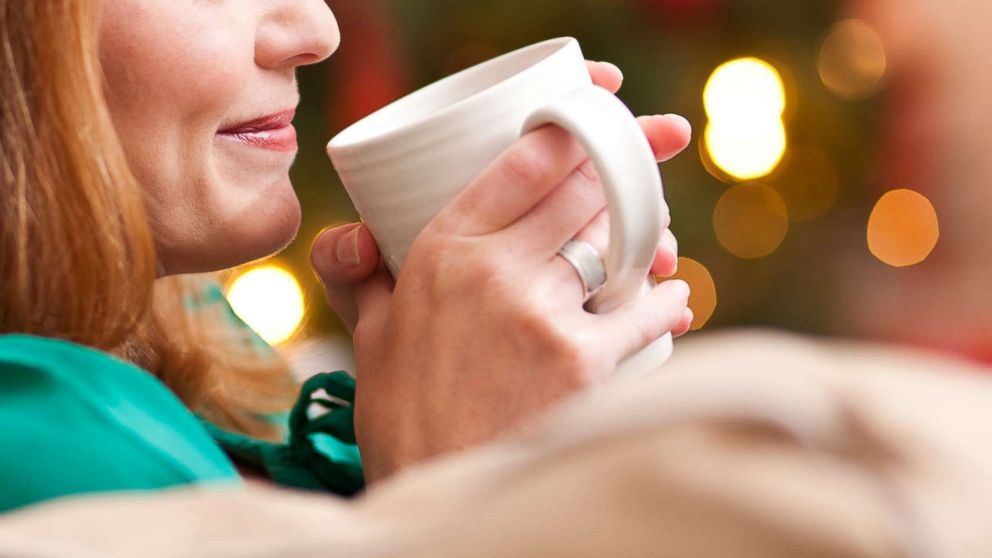 A woman drinks from a mug in an undated stock photo.