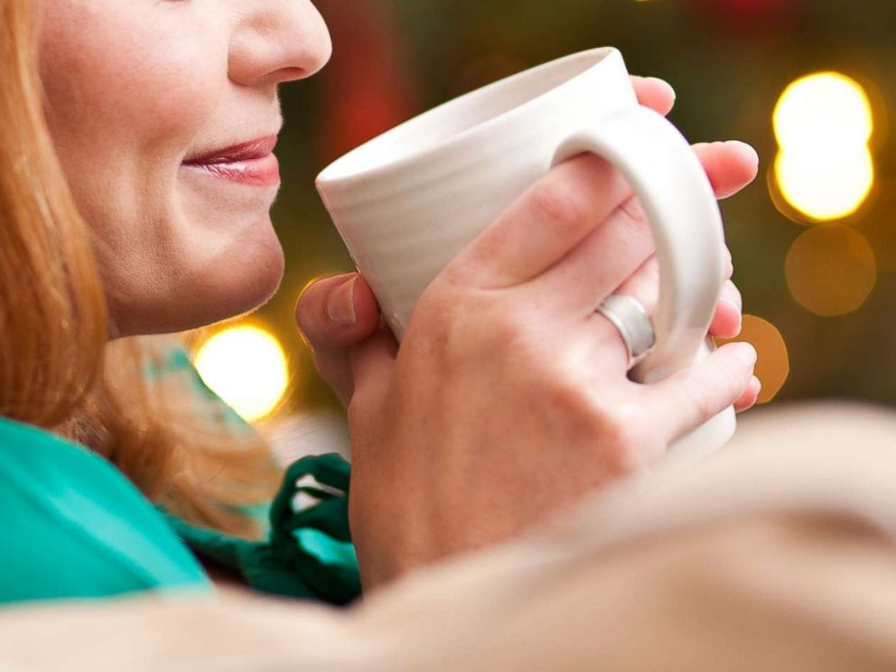 PHOTO: A woman drinks from a mug in an undated stock photo.