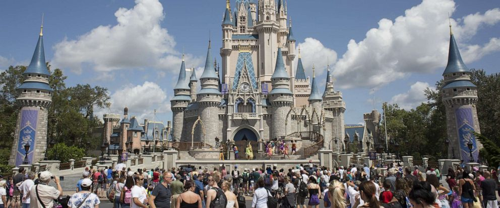 PHOTO: Visitors watch a performance at the Cinderella Castle at the Walt Disney Co. Magic Kingdom park in Orlando, Fla., Sept. 12, 2017.