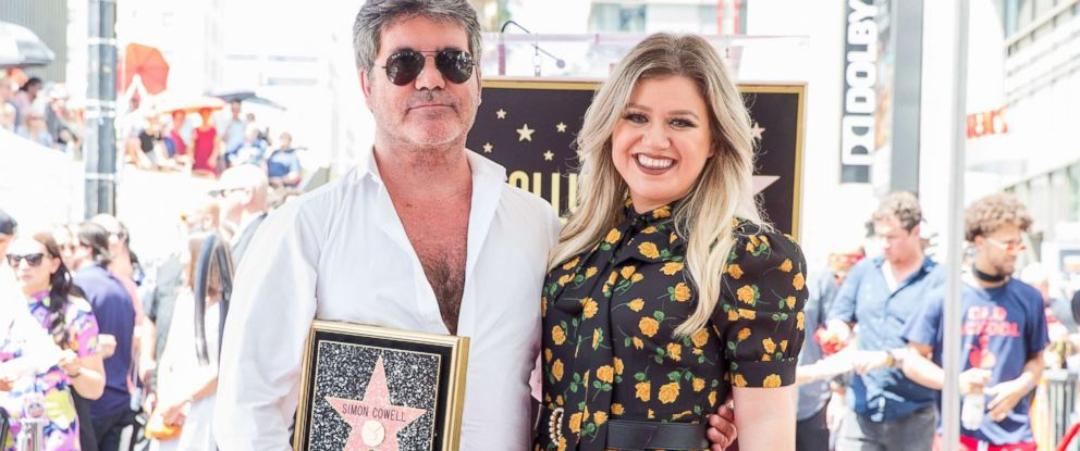 PHOTO: Simon Cowell and Kelly Clarkson attend a ceremony honoring Cowell with a star on the Hollywood Walk of Fame, Aug. 22, 2018, in Hollywood, Calif.
