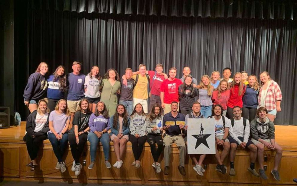PHOTO: 30 students from Tom Corbys AP Government and AP United States History class posed for a group picture with him after surprising him with tickets to see Hamilton.