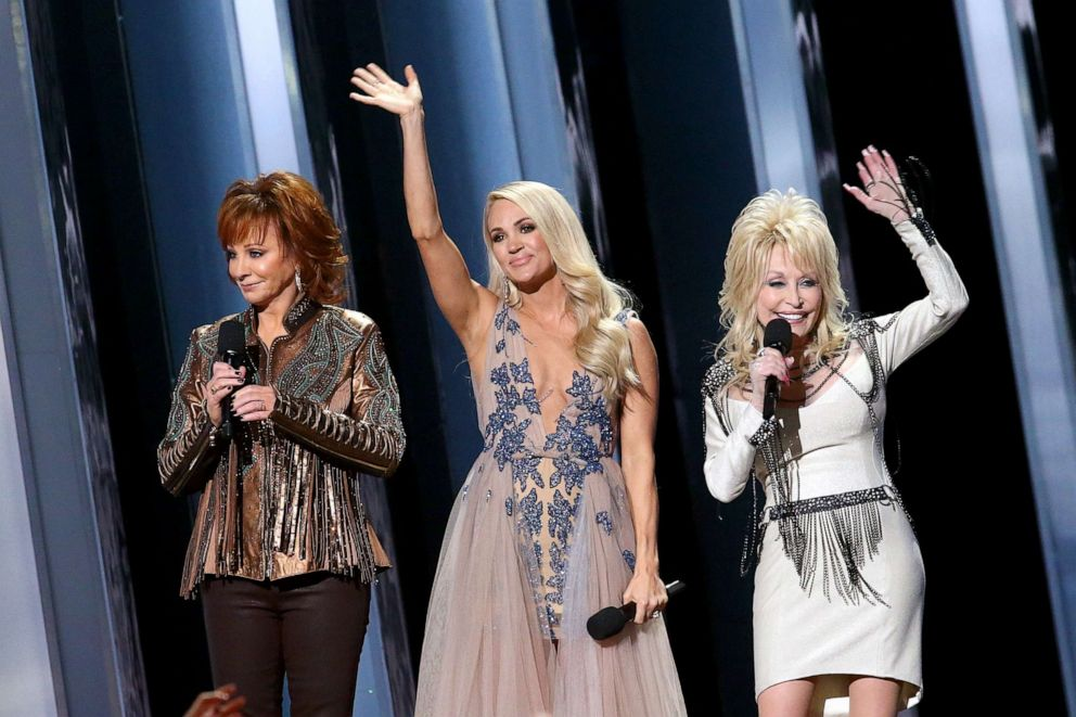 Reba McEntire, Carrie Underwood, Dolly Parton speak onstage during the 53rd annual CMA Awards at the Music City Center on November 13, 2019 in Nashville, Tennessee.