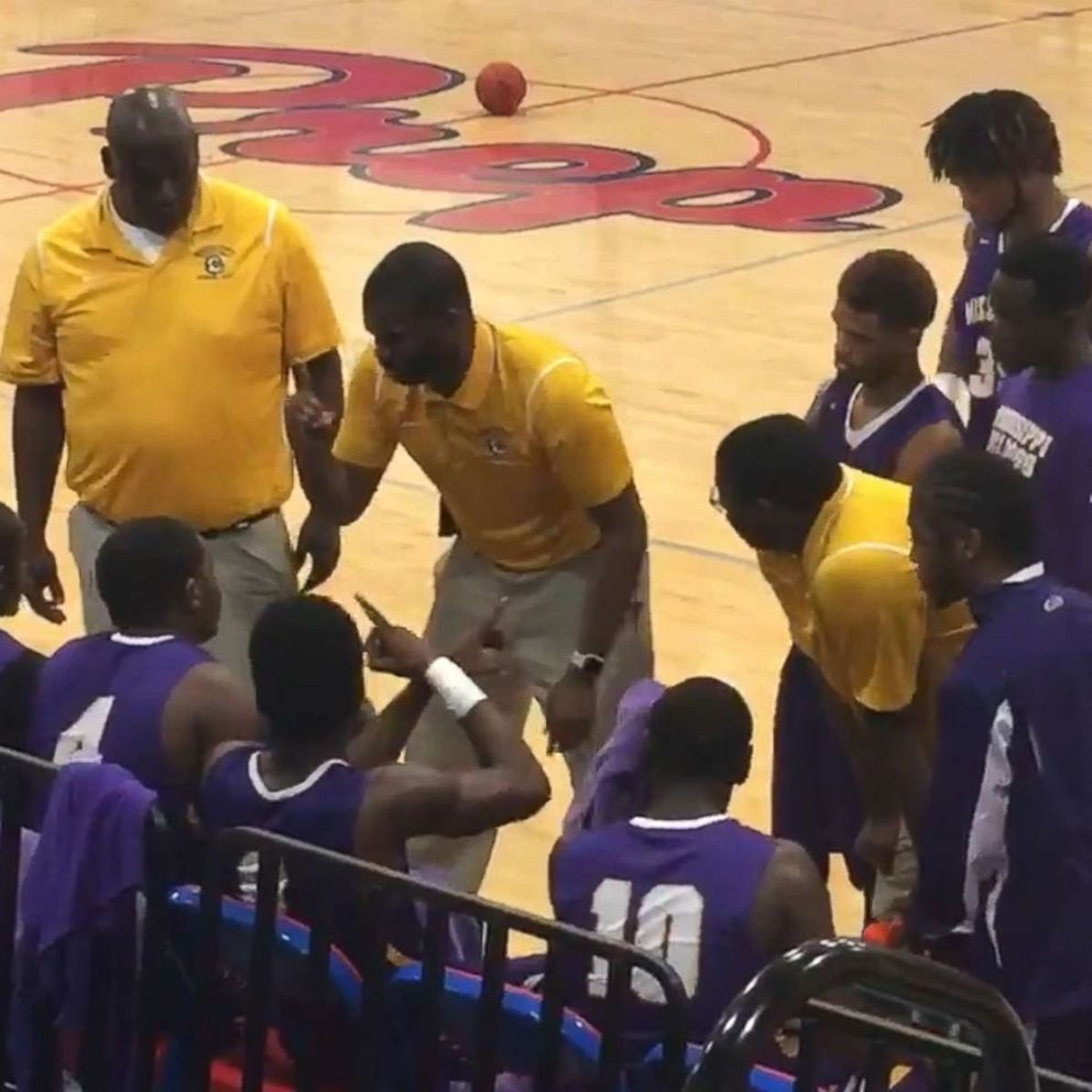 PHOTO: Coach Sekoe White of the Mississippi School for the Deaf was recorded as he used American Sign Language to communicate with his team.