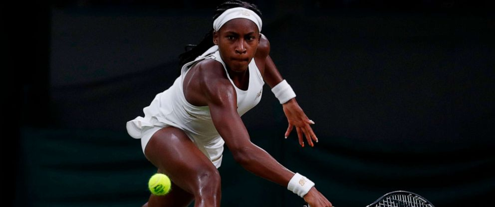 PHOTO: US player Cori Gauff returns against Slovakias Magdalena Rybarikova during their womens singles second round match on the third day of the 2019 Wimbledon Championships at The All England Lawn Tennis Club in Wimbledon.