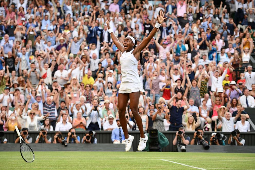 PHOTO: US player Cori Gauff celebrates beating Slovenias Polona Hercog during their womens singles third round match on the fifth day of the 2019 Wimbledon Championships at The All England Lawn Tennis Club in Wimbledon, southwest London, July 5, 2019.