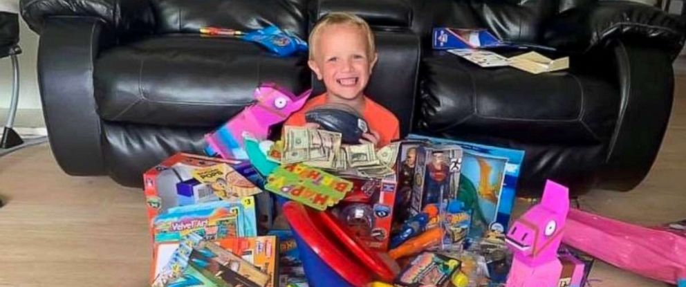 PHOTO: Colten Raymer is seen buried in his birthday gifts after a birthday party at Keystone Beach Park in Keystone Heights, Florida.