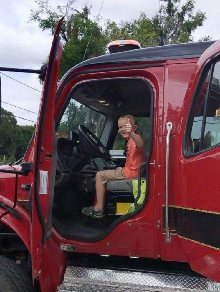 PHOTO: Colten Raymer sits inside of a fire truck after his birthday party at Keystone Beach Park in Keystone Heights, Florida.