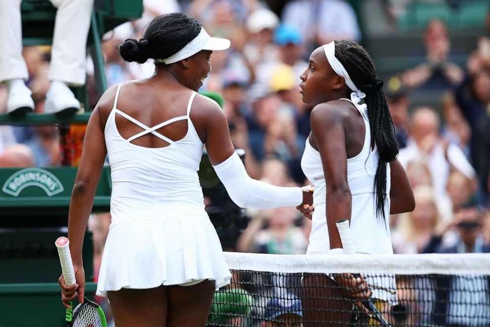 PHOTO: Cori Gauff of the United States shakes hands at the net with Venus Williams of the United States after her Ladies Singles first round match during day one of The Championships - Wimbledon 2019 on July 01, 2019 in London.