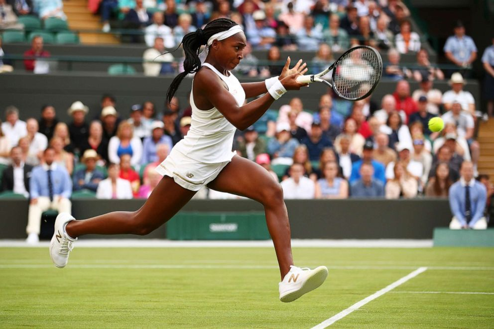 PHOTO: Cori Gauff of the United States plays a backhand in her Ladies Singles first round match against Venus Williams of the United States during day one of The Championships - Wimbledon 2019 on July 01, 2019, in London.