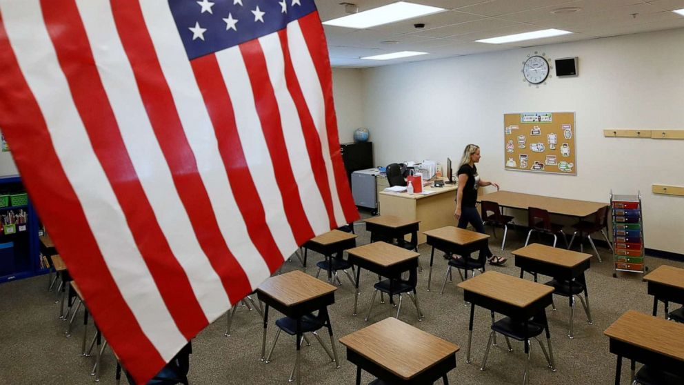 PHOTO: A teacher sets up her classroom to restart school at Freedom Preparatory Academy in Provo, Utah, Aug. 13, 2020.