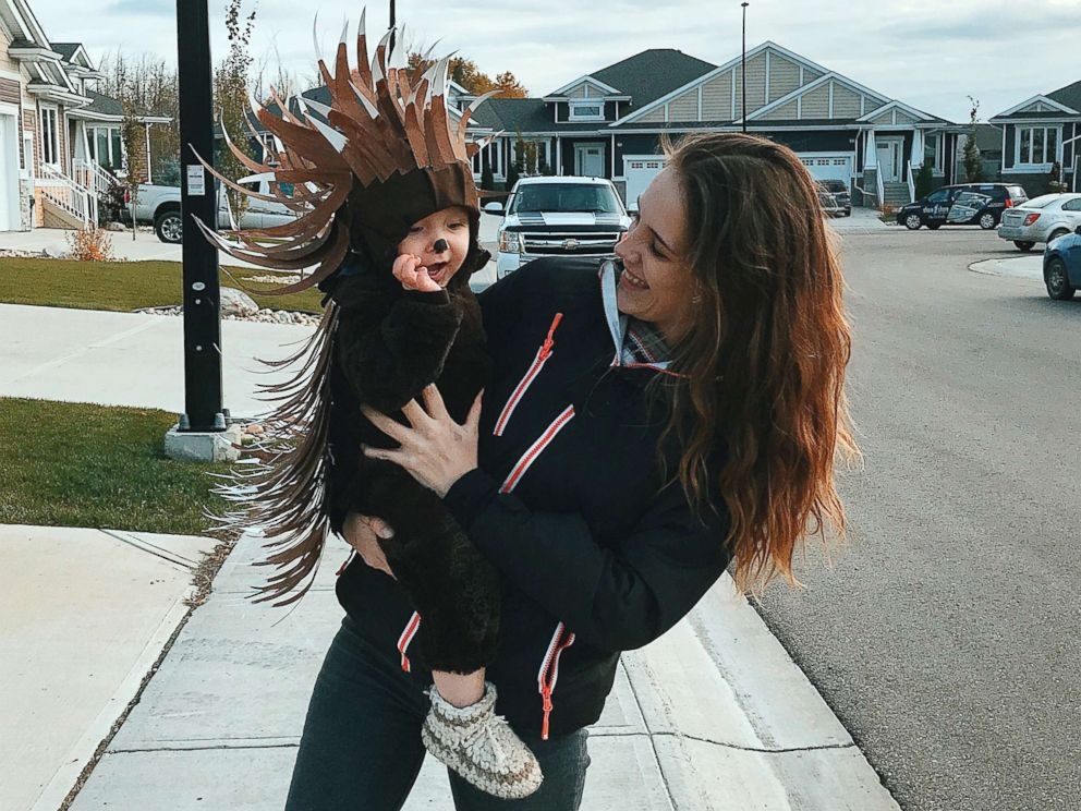PHOTO: Danielle Bevens holds her son, dressed in a porcupine costume.