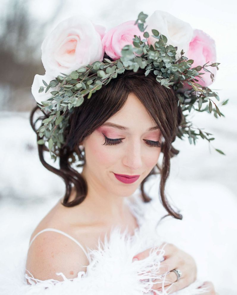 A model displays a flower crown crafted from cotton candy in a wedding-style photo shoot by Milwaukee-based wedding photographer Lottie Lillian.