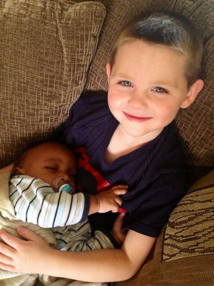 PHOTO: Scott Fessenden, 11, is seen holding his baby brother Mason.