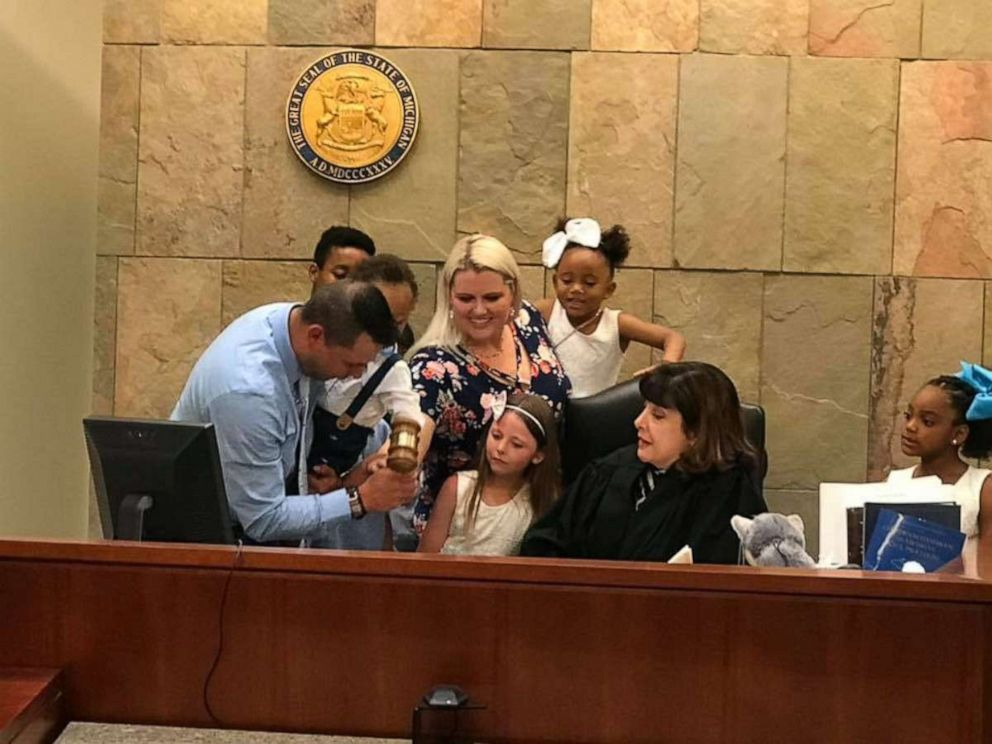 PHOTO: Gabrielle Fessenden and Shannon Fessenden of White Cloud, Michigan, are seen with their children June 12, 2019, during their son Masons adoption hearing.