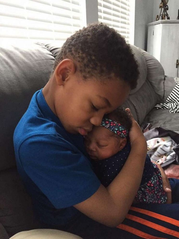 PHOTO: Milo Weight, 5, is seen in an undated photo holding his baby sister Onni, 3 months. The children share the same birth mother and were adopted into the same family.