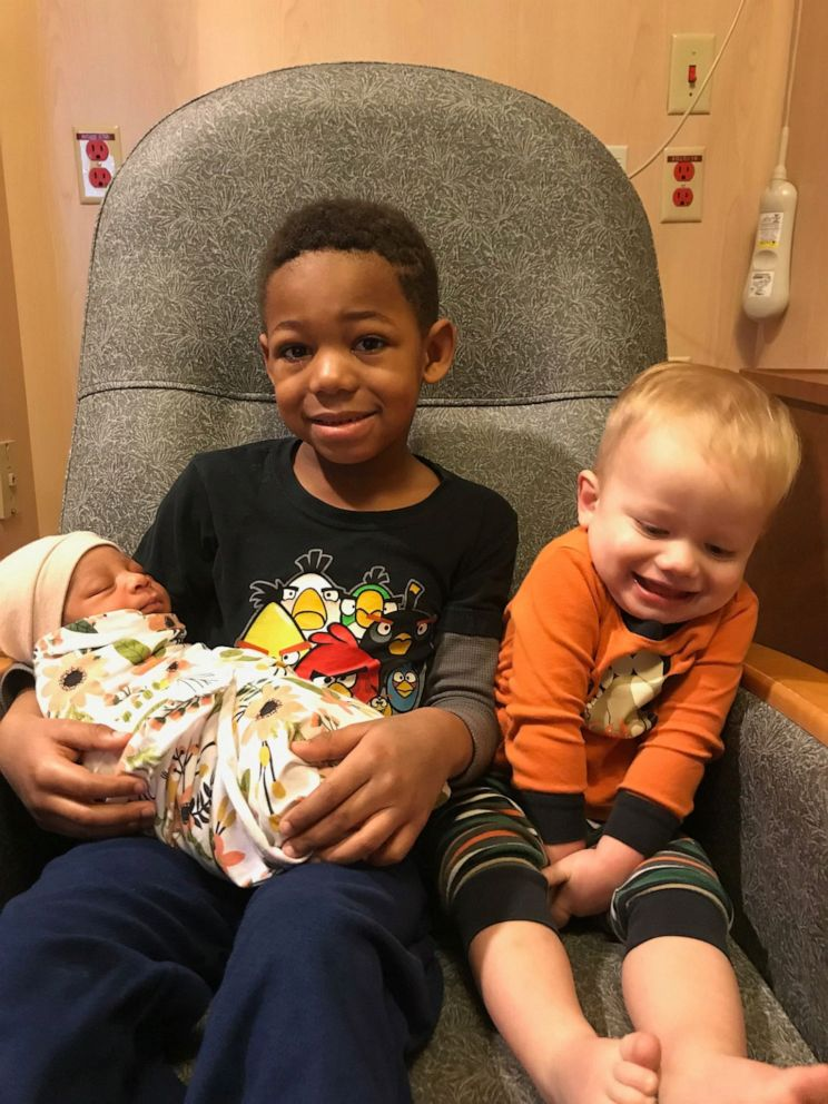 PHOTO: Milo Weight, 5 and his brother Nash Weight, 2, hold their baby sister Onni Weight, 3 months after her 2019 adoption in Utah.