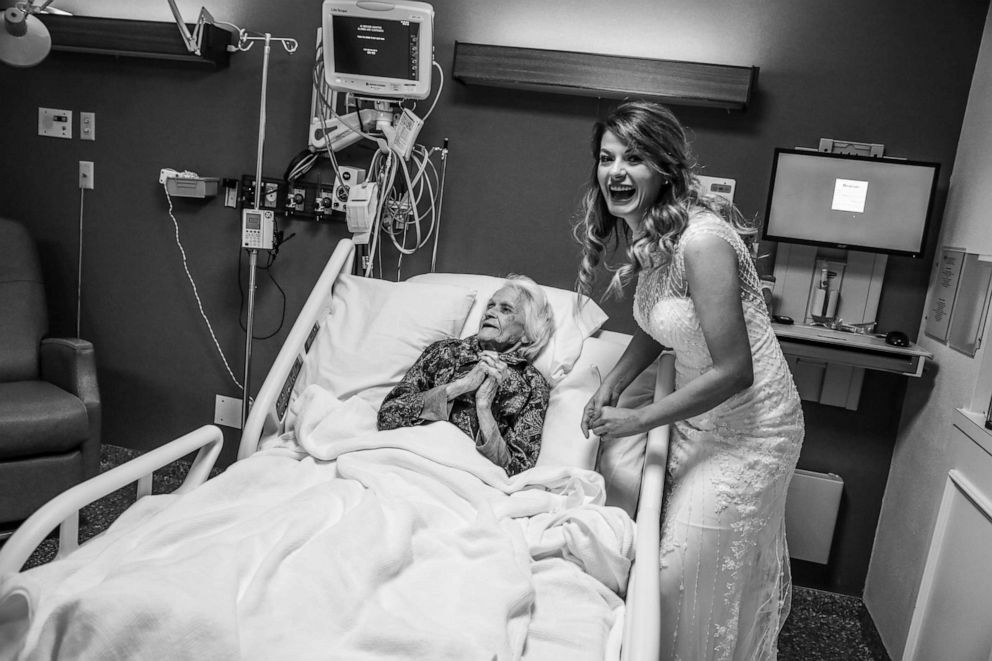 PHOTO: Sky Howard stands with her fiances grandmother, Charlotte Bussard, 100, at Hemphill County Hospital in Hemphill County, Texas.
