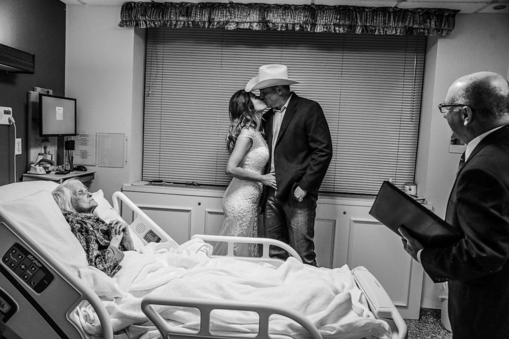 PHOTO: Charlotte Bussard, 100, looks on as her grandson, Clay Cameron, weds Sky Howard at Hemphill County Hospital in Hemphill County, Texas.