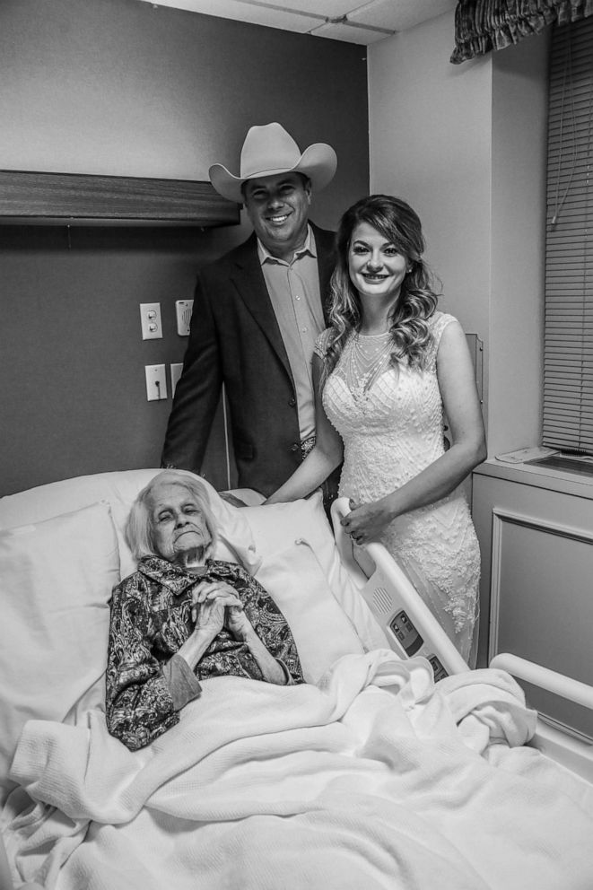 PHOTO: Charlotte Bussard, 100, stands with her grandson, Clay Cameron, on the day he wed Sky Howard in an unofficial ceremony at Hemphill County Hospital in Hemphill County, Texas.