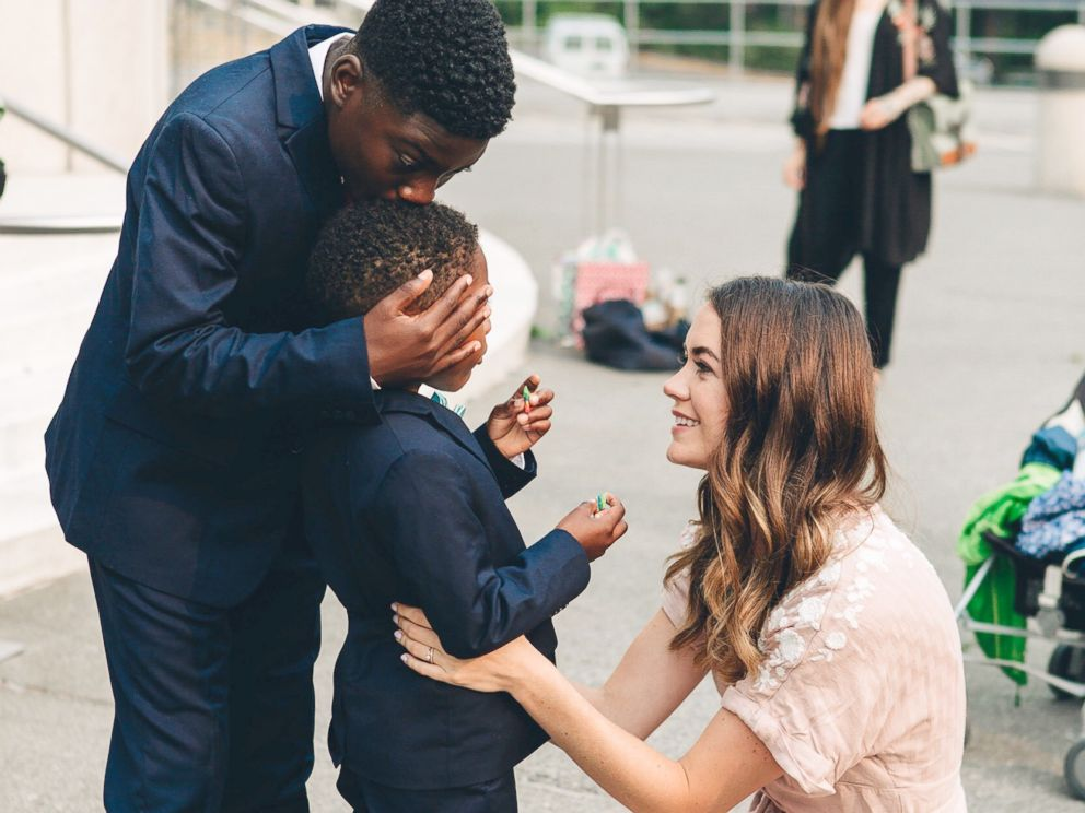 PHOTO: Dayshawn kisses Michael on the head while Sara Cozard looks on in this adoption day photograph, Aug. 13, 2018.