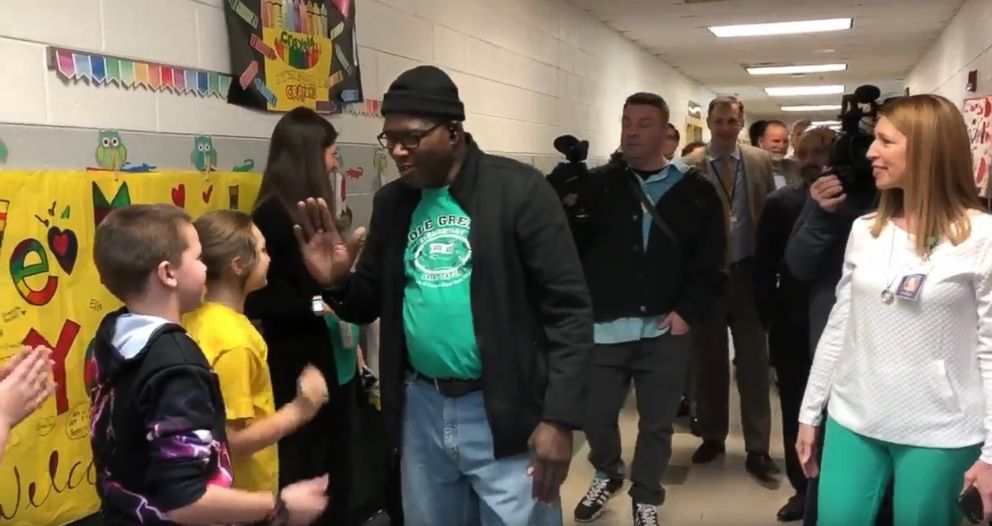 PHOTO: Tyrees Dandridge, known to students as Mr. D., high fives students at Pole Green Elementary School in Virginia, on Feb. 25, after he received a heart and kidney transplant.