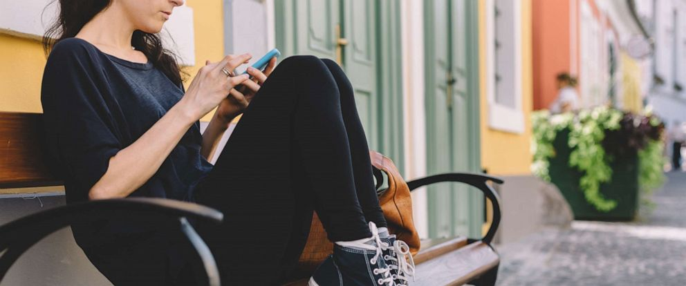 PHOTO: A young woman uses a smartphone in this undated stock photo.