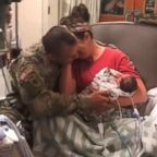 Skyler Cooper, a member of the Kansas Army National Guard, surprises his wife, Cydney Cooper of Topeka, Kansas and their newborn twins, Emma and Kyla Cooper.