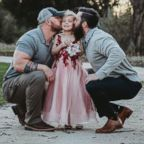 Dylan Lenox (left) is pictured with David Lewis (right) and their daughter Willow (center) before a daddy-daughter dance.