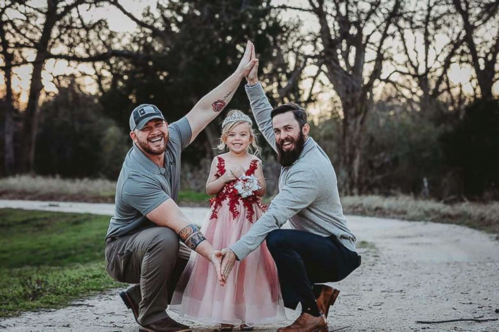 PHOTO: Dylan Lenox (left) is pictured with David Lewis (right) and their daughter Willow (center) before a daddy-daughter dance.